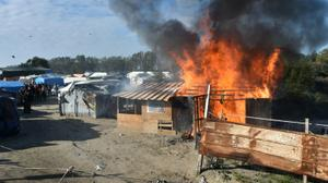 Migrants stream out of Calais 'Jungle' as demolition begins