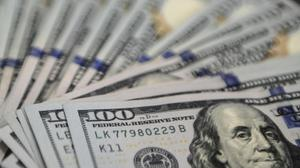 Dollar surges, most markets sink on Fed rate call