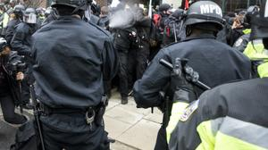 Over 200 arrests as anti-Trump protesters, police clash in Washington