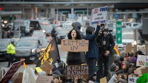 'More streamlined' US travel ban will spare visa, green card holders: official