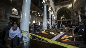 Islamic State group claims Sunday's Cairo church bombing that killed 25