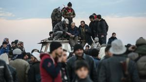 Syrians mass on Turkish border as regime advances near Aleppo
