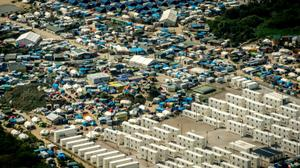 Migrant camp in Calais to be dismantled: French minister