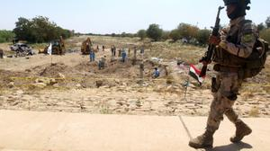 More than 50 mass graves uncovered in ex-IS territory in Iraq: UN