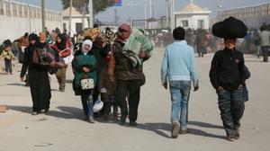 Germany's Merkel heads to Turkey as Syrians wait at border