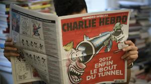 Two years after massacre, Charlie Hebdo continues to gleefully offend