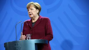 Merkel's liberal refugee policy 'unsustainable', says French PM