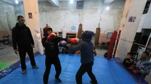In Syria's Aleppo city, young boys box to drown out bombs