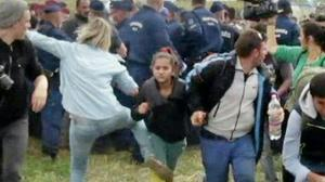 Migrant-kicking camerawoman charged in Hungary