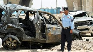 Suicide bomber kills at least 12 in north Baghdad: officials