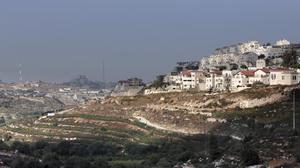 Four Palestinians detained by PA security after visiting Israeli settlement for...