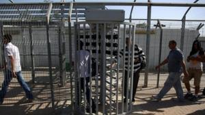 Three Palestinians arrested under suspicion of bribing Israeli guard for permits