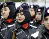Police academy graduates march during their graduation ceremony in Islamabad, Pakistan May 18, 2015. Out of the 408 graduating officers, 76 female officers were inducted into the Pakistan police force, according to the police force ( REUTERS/Caren Firouz )