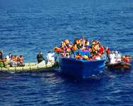 An Italian Navy vessel rescues refugees in the Mediterranean Sea on September 8, 2014 in an operation assisted by the Migrant Offshore Aid Station (MOAS) ( Ho (MOAS/AFP/File) )