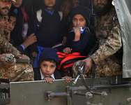 Pakistani soldiers transport rescued children from the site of the Taliban attack on a school in Peshawar  ( A Majeed (AFP) )