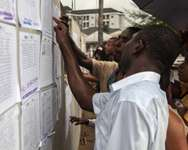 Volunteers check their ballot station positions in the Bayelsa state capital of Yenagoa on March 27, 2015 on the eve of Nigeria's presidential election ( Florian Plaucheur (AFP) )