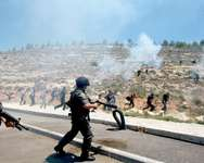 Israeli border guards fire tear gas canisters during clashes with Palestinian protesters marking the 66th anniversary of the Nakba, on May 15, 2014, near the West Bank village of Walajah ( Musa Al-Shaer (AFP) )