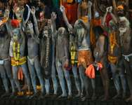 Indian Hindu holy men chant religious slogans as they prepare for the first holy dip at the Kumbh Mela in Trimbakeshwar near Nashik on August 29, 2015 ( Punit Paranjpe (AFP) )