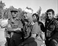Israeli army Southern Command General Ariel Sharon with Defense Minister Moshe Dayan during the Yom Kippur War in October 1973 on the western bank of the Suez Canal in Egypt ( AFP )