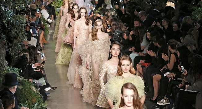 Models present creations by Lebanese designer Elie Saab as part of his Haute Couture Spring Summer 2015 fashion show in Paris January 28, 2015 ( AFP )