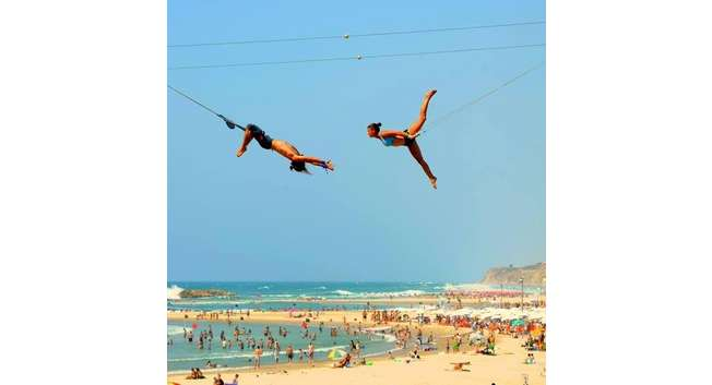 Trapeze artists perform at the Acco festival in northern Israel ( Jeremie Elfassy )