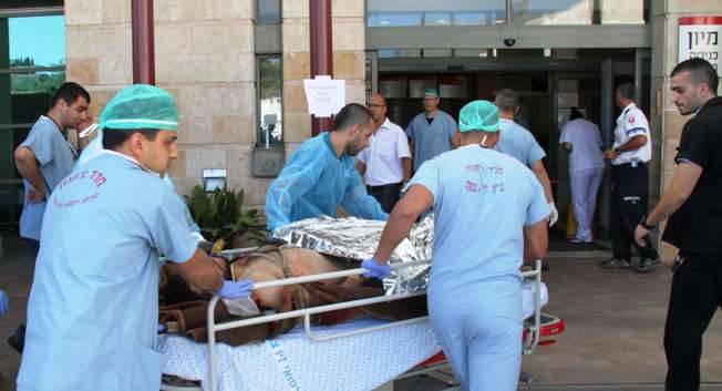 An injured Syrian is being rushed to treatment in Ziv Hospita, Safed ( Hannah Bikel )