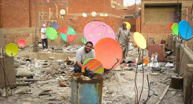 The Cairo Dish-Painting initiative kicked off in Giza, Cairo's next-door governorate where a U.S. artist (not pictured) hosted by a local art collective began giving the pale dishes a personalized touch ( Facebook )