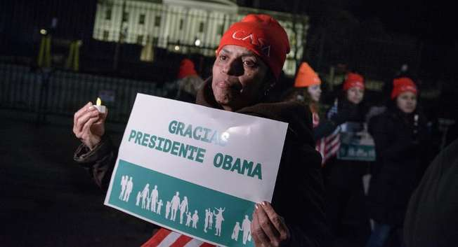 Immigration activists celebrate on Pennsylvania Avenue outside the White House November 20, 2014 in Washington, DC ( Brendan Smialowski (AFP) )