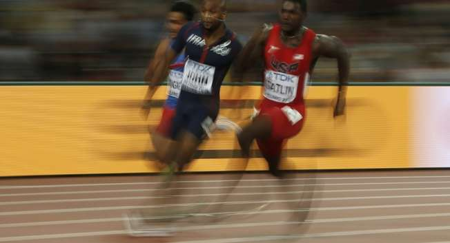 USA's Justin Gatlin (R) and France's Jeffrey John compete in a heat of the men's 200 metres at the 2015 IAAF World Championships in Beijing on August 25, 2015 ( Adrian Dennis (AFP) )