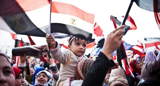 Egyptians wave the national flag in Cairo's Tahrir Square during a rally marking the anniversary of the 2011 Arab Spring uprising on January 25, 2014 ( Virginie Nguyen Hoang (AFP) )