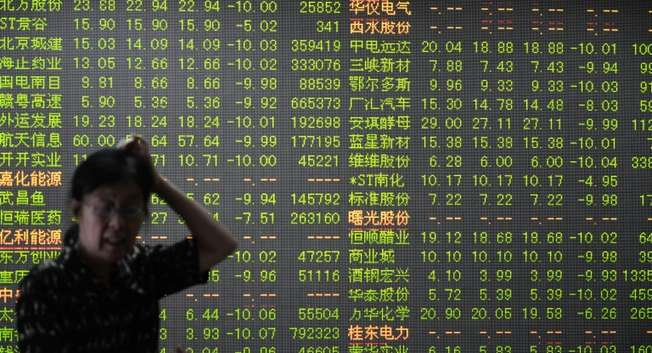 Asian stocks tumbled after Greece was slapped with a deadline, while fears over the collapse in Shanghai have spilled into other markets ( AFP )
