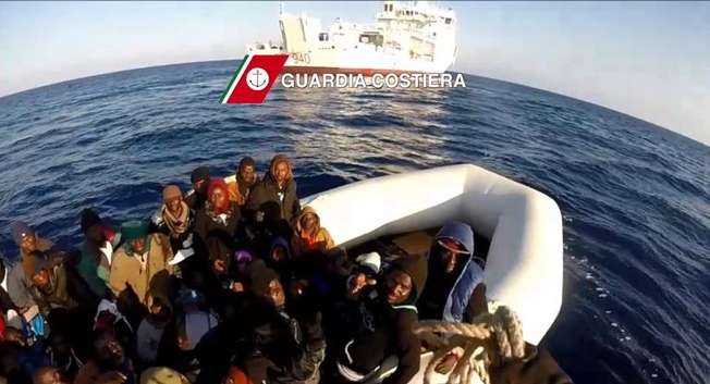 In this video grab released by the Italian Guardia Costiera on April 17, 2015 migrants sit in a boat during a rescue operation on April 15 off the coast of Sicily as part of the Triton plan ( Guardia Costiera/AFP )