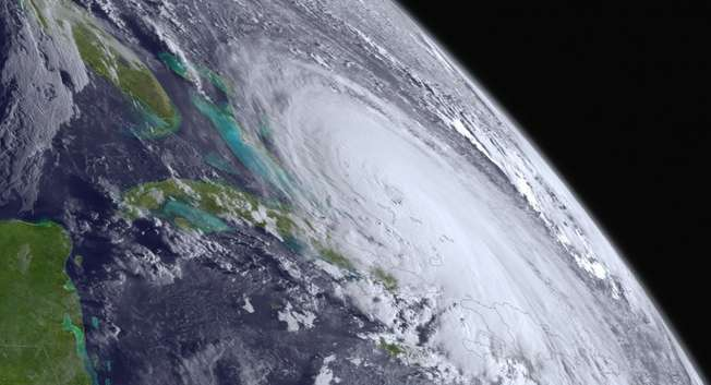 This NOAA image shows Hurricane Joaquin at the far eastern periphery of the GOES West satellite's full disk extent, taken at 1200Z on October 1, 2015 ( NOAA / HO/AFP )