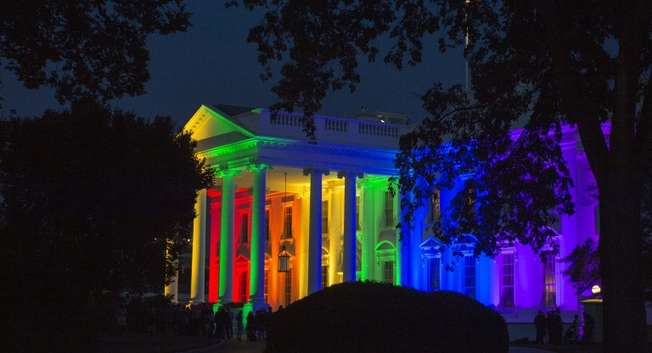 The White House is blanketed in rainbow colors symbolizing LGBT pride, in Washington, DC, on June 26, 2015 ( Molly Riley (AFP) )