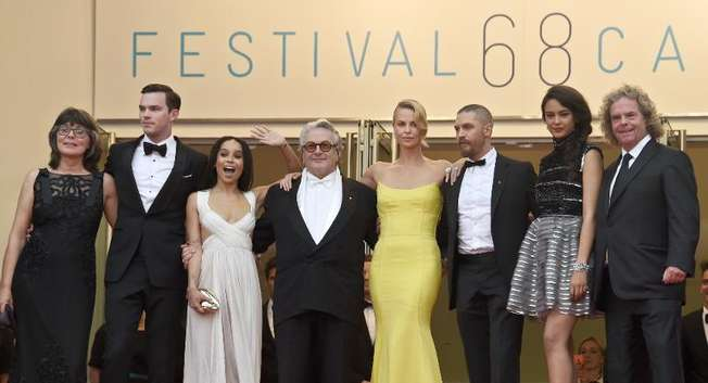 """Margaret Sixel (L), Nicholas Hoult, Zoe Kravitz, George Miller, Charlize Theron, Tom Hardy, Courtney Eaton and Doug Mitchell pose as they arrive for the screening of """"Mad Max: Fury Road"""" during the 68th Cannes Film Festival in Cannes, on May 14, 2015 ( Loic Venance (AFP) )"""