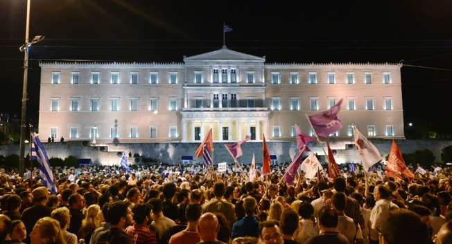 People celebrate in Athens on July 5, 2015 after the first exit-polls of the Greek referendum ( Louisa Gouliamaki (AFP) )