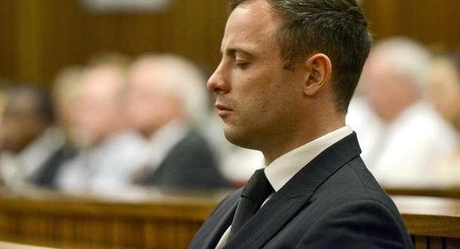 Oscar Pistorius à l'énoncé du verdict le 21 octobre 2014 au tribunal à Pretoria ( Herman Verwey (Pool/AFP) )