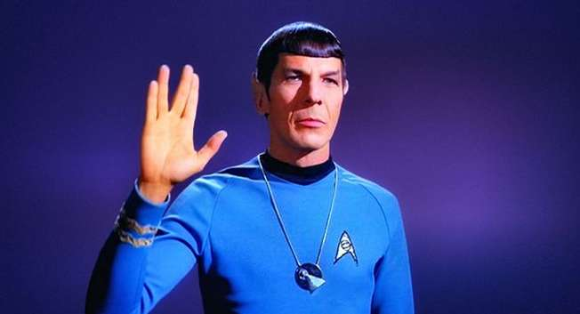 Leonard Nimoy as his famous Mr.Spock giving the Vulcan salute ( Wikipedia )