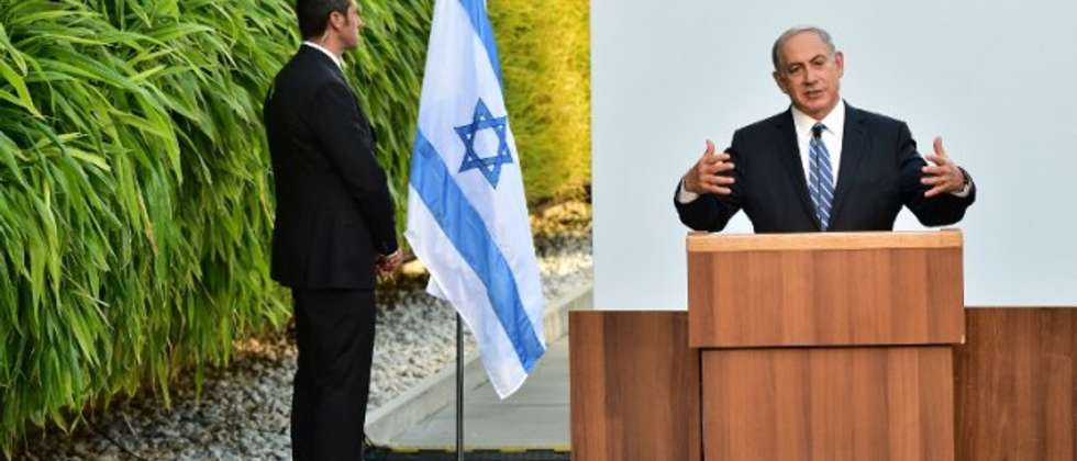 Prime Minister Benjamin Netanyahu delivers a speech as a security guard stands near him during a visit at the Universal Exhibition 2015 (Expo Milano 2015 or World Exposition 2015) in Milan on August 27, 2015. (Giuseppe Cacace/AFP))