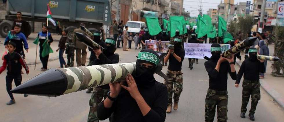 Palestinian militants from the Ezzedine al-Qassam brigade, the armed wing of Hamas, carry mock-rockets at a rally at the Nuseirat refugee camp in the Central Gaza Strip on December 12, 2014 (Said Khatib (AFP/File))