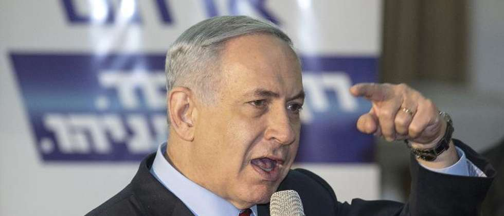 Israeli Prime Minister Benjamin Netanyahu addresses Likud supporters during an election campaign meeting in Netanya, on March 11, 2015 (Jack Guez (AFP))