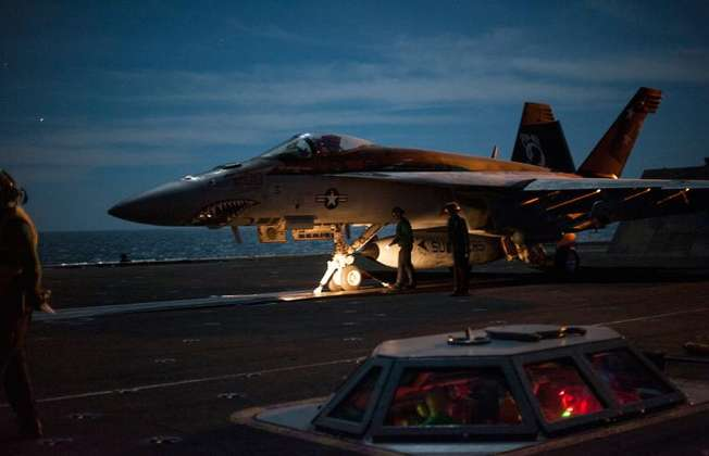 The US-led coalition expanded its air strike campaign against IS militants based inside Iraq and Syria in September 2014 (Mc2 John Philip Wagner Jr. (US NAVY/AFP/File))