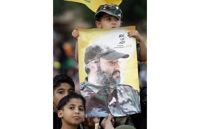 Young Lebanese Hezbollah supporters hold a portrait of the movement's slain commander Imad Mughniyeh during a festival in southern Beirut on May 25, 2009 (Ramzi Haidar (AFP/File))