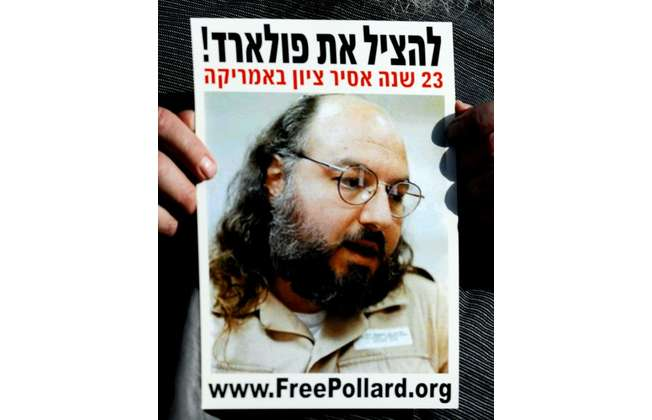 An Israeli right-wing demonstrator holds a picture of Jonathan Pollard, a Jewish American who was jailed in 1987 on charges of spying on the United States, during a protest in Jerusalem in 2008 (Joe Klamar (AFP/File))