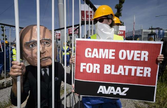 A demonstrator disguised as FIFA President Sepp Blatter takes part in a protest against the condition of workers in Qatar, on the sidelines of the 65th FIFA Congress on May 28, 2015 in Zurich ( Fabrice Coffrini (AFP) )