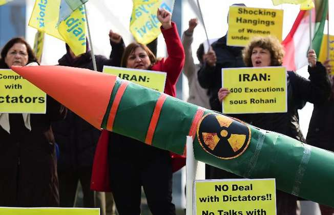 Iranian opposition supporters stage a demonstration displaying a fake nuclear missile ahead of nuclear talks between EU foreign ministers and Iran (Emmanuel Dunand (AFP/File))