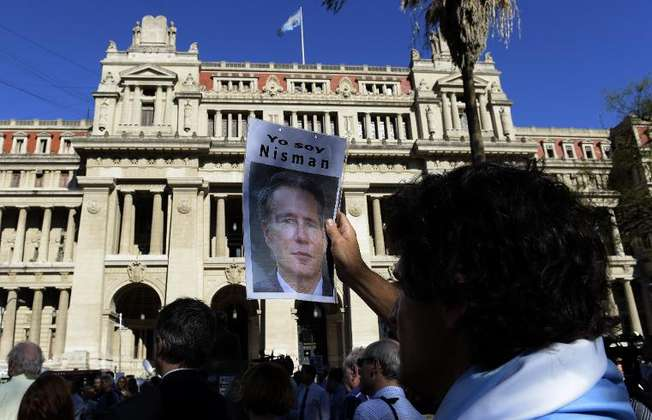 A man holds a portrait of late Argentine prosecutor Alberto Nisman during a demonstration in demand of justice, in front of the law court in Buenos Aires on March 18, 2015 (Juan Mabromata (AFP/File))