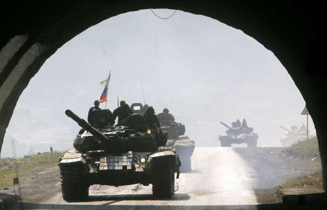 Russia's stated aim for military intervention in Syria is to target the Islamic State group, but analysts say it is trying to prop up President Bashar al-Assad's embattled regime against a broader group of rebels (Viktor Drachev (AFP/File))