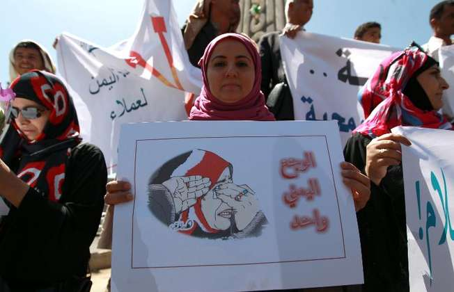 A Yemeni woman holds a poster during a rally against Saudi-led coalition airstrikes against Huthi rebels on March 29, 2015 in Sanaa (Mohammed Huwais (AFP))