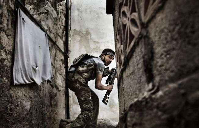 This photo of a Free Syrian Army fighter taking up a position during clashes against government forces in the Sulemain Halabi district of Aleppo on October 10, 2012 is part of Fabio Bucciarelli's award winning series 'Battle to Death' (Fabio Bucciarelli (AFP/File))